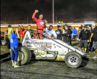 Dave Darland celebrates in victory lane at Canyon.