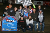 Craig Carroll and his team celebrate after their victory at Creek County Speedway.