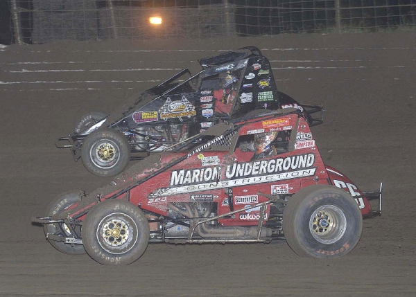 Dave Darland (outside) assumed the lead and held of Jon Stanbrough (inside) to win Saturday in West Memphis, Arkansas.