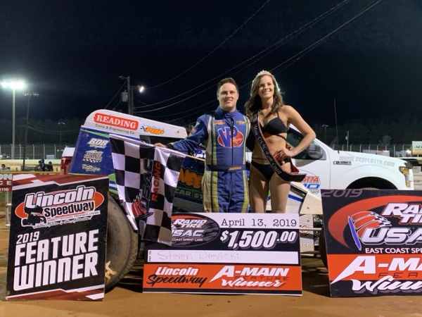 Steven Drevicki celebrates victory at Lincoln Speedway.