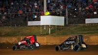Kyle Larson (#86) on his way to victory in Thursday night's Indiana Midget Week feature at Lincoln Park Speedway. Tanner Thorson (#19) finished second.
