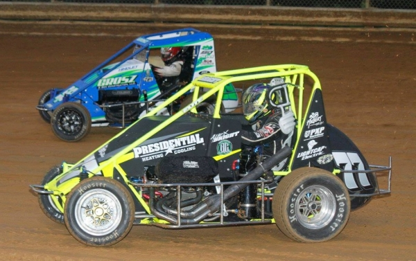 Alex Bright (#77) battles Justin Grosz during the 2016 Pennsylvania Midget Week round at Lanco's Clyde Martin Memorial Speedway.