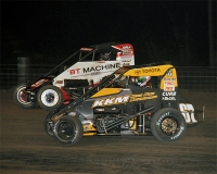 Tanner Thorson (black) battles Tyler Thomas in last year's USAC P1 Insurance National Midget feature at Jefferson County Speedway in Fairbury, Nebraska.