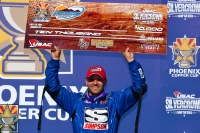 "Bobby Santos celebrates his victory in the ""Phoenix Copper Cup"" Saturday at Phoenix Raceway."