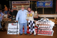 "Team owner Fred Gormly (left) and winning driver Chris Windom celebrate in victory lane at Williams Grove Speedway after winning Friday night's ""Horn/Schindler Memorial."""