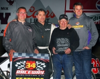 Jeff Mallonee (2nd from left) stands in victory lane after winning Saturday night's USAC Speed2 IMRA Midget Feature at 34 Raceway.