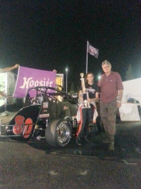 Toni Briedinger poses after winning her first USAC feature!