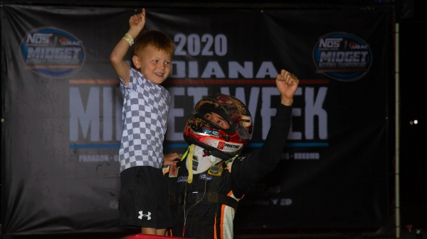 Kyle Larson celebrates with his son, Owen, after winning his third consecutive Indiana Midget Week feature Thursday at Lincoln Park Speedway.