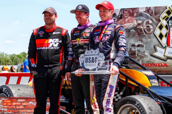 "Bobby Santos (left), Kody Swanson (middle) and winner Tanner Swanson (right) stand in victory lane after finishing on the podium at Lucas Oil Raceway's ""Day Before the 500"" in May of 2015."