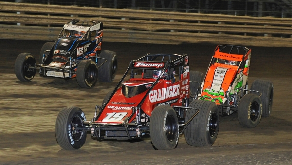 #19 Kevin Thomas, Jr., #69 Brady Bacon and #5G Chris Windom battle for the lead Friday at Knoxville.