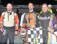 Winner Will Hull (middle) is joined by Seth Carlson (right) and Joe Krawiec (left).in victory lane.