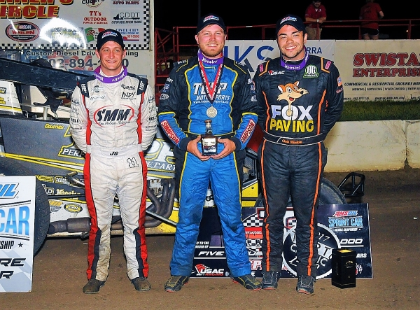 Winner Tyler Courtney (middle) is joined in victory lane by 2nd place finisher Chris Windom (right) and 3rd place finisher Justin Grant (left).