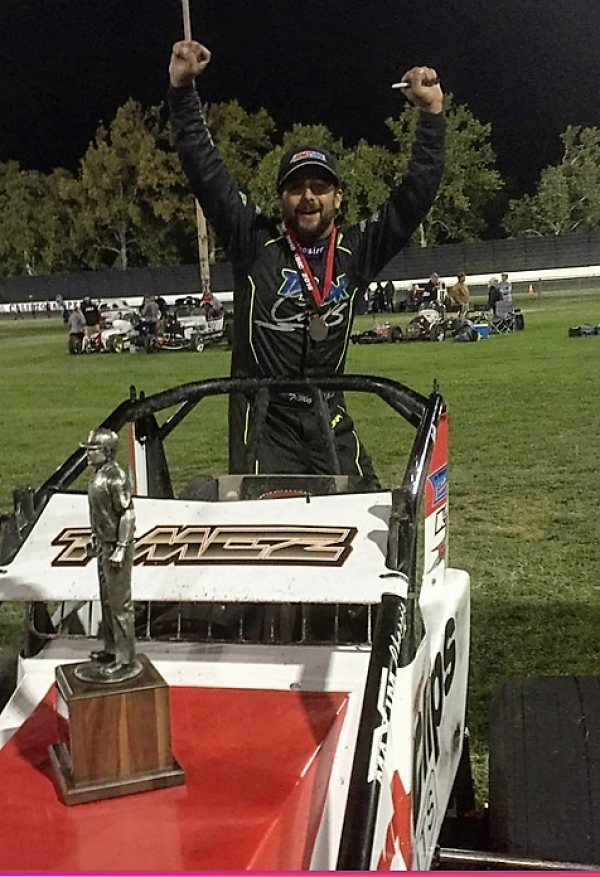 "Thomas Meseraull celebrates after winning Sunday night's ""Louie Vermiel Classic"" AMSOIL USAC/CRA Sprint Car feature at Calistoga (CA) Speedway."