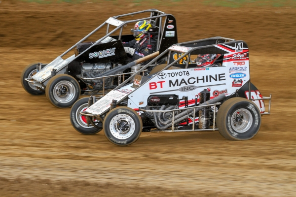 #91T Tyler Thomas battles Chase Jones during the 2018 USAC NOS Energy Drink National Midget season.