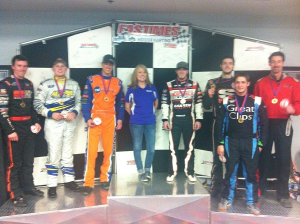 Kevin Thomas Jr. and team pose for the winners' photo at Fun at Fastimes.