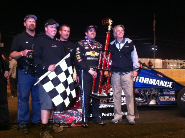 "The Tony Stewart/Curb-Agajanian Racing team celebrates in victory lane after Levi Jones' ""Hoosier Hundred"" win Friday..."