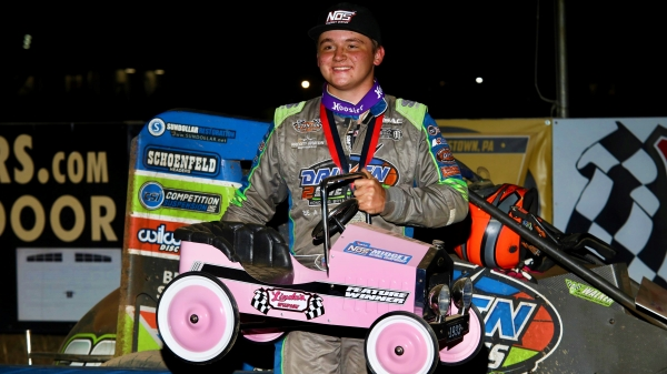 Zeb Wise proudly holds the pedal car trophy after capturing Friday night's Pennsylvania Midget Week feature at Linda's Speedway.