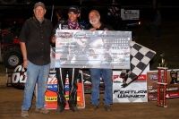 Bryan Clauson celebrates in victory lane with Joe Dooling, Sr. (L) and chief mechanic Rusty Kunz (R).