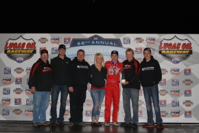 "Darren Hagen and his RFMS Racing team celebrate after their ""Night Before the 500"" victory."