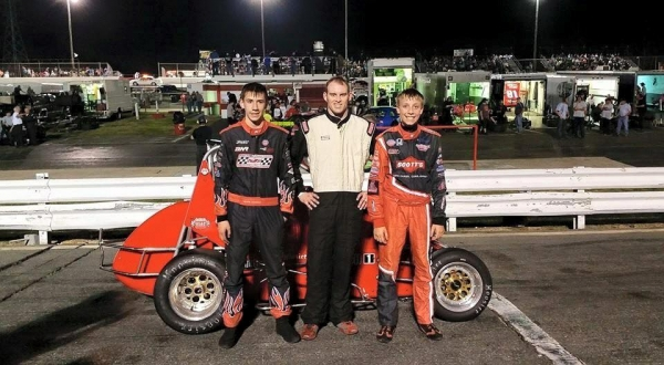 Winner Matt Lundstrom is joined by Calvin Carroll and Carson Hocevar in victory lane at Ace Speedway.
