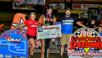 Danny Smith (middle) celebrates Friday's USAC Wingless Sprints Oklahoma feature victory at Creek County Speedway.