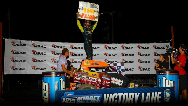 Jason McDougal celebrates his first career USAC NOS Energy Drink National Midget win Friday night at Jefferson County Speedway.