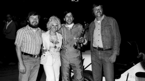 After his USAC National Midget win on May 16, 1976, Bruce Robey (2nd from right) poses with June Cochran (2nd from left), plus event promoters and photographers Gene Crucean (far left) and John Mahoney (far right).