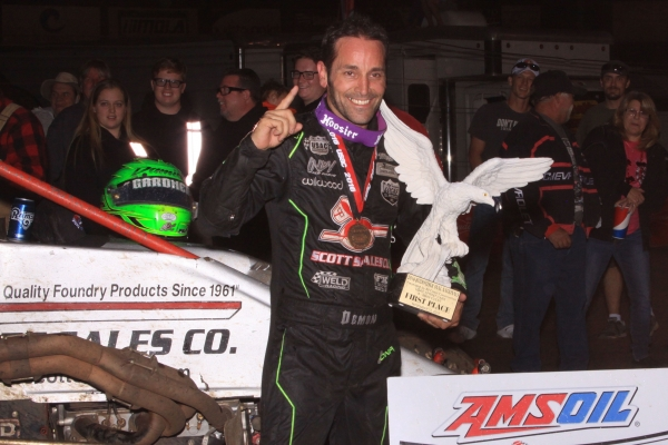"Damion Gardner carries the Eagle trophy after winning the season-ending ""Oval Nationals"" at Perris (Calif.) Auto Speedway on Nov. 12, 2016."