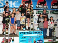 Winner Richard Vander Weerd (middle) celebrates in victory lane alongside 2nd place finisher Ryan Bernal (left) and 3rd place finisher Tristan Guardino (right).