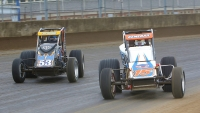 #15 Chad Kemenah & #53 Shane Cockrum tussle in the USAC Silver Crown race at the Illinois State Fairgrounds.