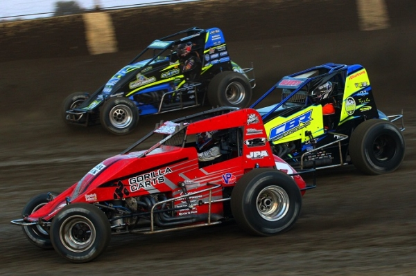 "Close racing action at Kokomo (Ind.) Speedway during the 2018 running of ""Sprint Car Smackdown."""