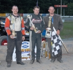 Winner Adam Pierson is flanked by Kevin Chaffee and Joe Krawiec after winning at Bradford.