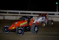 "#5 Chris Windom and #2E Nick Bilbee battle for position Thursday night in ""Winter Dirt Games."""