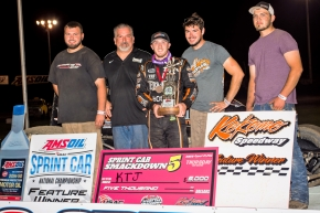 "Kevin Thomas, Jr. and the 4J Motorsports crew celebrate in victory lane after winning Thursday night's ""Sprint Car Smackdown V"" opener at Kokomo (Ind.) Speedway."