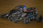 "Eventual winner #7BC Tyler Courtney and #30 C.J. Leary battle for the lead late in the feature of Sunday's NOS Energy Drink ""Indiana Sprint Week"" event at Lawrenceburg Speedway."