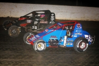 "C.J. Leary (in black) battles Kevin Thomas, Jr. for the lead during Saturday night's ""4-Crown Nationals"" USAC Silver Crown race at Eldora Speedway."