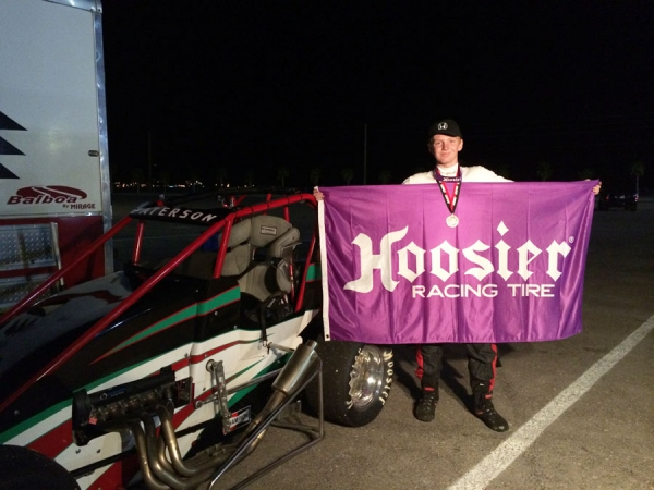 Thomas Paterson poses in victory lane at LVMS.