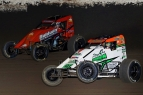 "Chad Boespflug (white) and Chris Windom (orange) battle for the lead at Haubstadt, Indiana's Tri-State Speedway in Saturday night's ""Spring Showdown."""