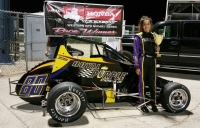Toni Breidinger stands in victory lane after winning her ninth career USAC Western HPD Midget race, tying Ashley Hazelton as the winningest female driver in the history of USAC.