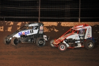Logan Seavey (black) and Jason McDougal battle for position.