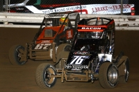 "Brady Bacon (#76m) and Tanner Thorson (#67) battle for the lead during Friday night's ""Jason Leffler Memorial"" at Wayne County Speedway in Wayne City, Illinois."