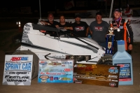 "Chad Boespflug and crew celebrate their USAC AMSOIL National Sprint Car victory Friday night at Eagle (Neb.) Raceway's ""Rumble in the Bullring."""