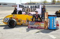 "Kody Swanson holds the check after winning Sunday's ""Rollie Beale Classic"" at Toledo Speedway."