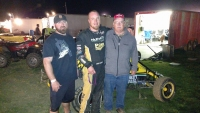 Andy Baugh (middle) celebrates with crew after winning Saturday night's USAC IMRA Midget feature at Spoon River.