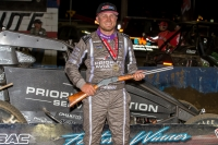 "Tyler Courtney celebrates in victory lane with the ""Tony Hulman Classic"" rifle after winning Wednesday night's USAC AMSOIL National Sprint Car feature at the Terre Haute (Ind.) Action Track."