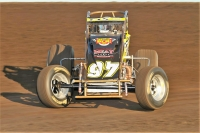 Bret Mellenberndt in the Rock and Roll Gold Cup-sponsored sprint car.