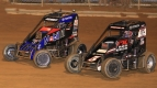 Kevin Thomas, Jr. (#5) battles Logan Seavey (#67) during the 2019 USAC NOS Energy Drink National Midget season.