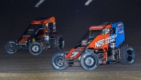 Tyler Courtney (#7BC) and Jason McDougal (#76m) wheel-to-wheel during the 2019 USAC NOS Energy Drink National Midget season.