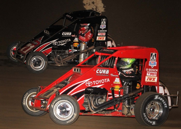 "Christopher Bell (outside) flashes by his teammate Kyle Larson to win the race at Kokomo and ""Indiana Midget Week"""