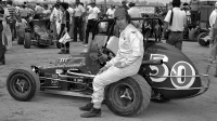 "Before qualifying began in 1978 for the ""Hut 100"" at the ""Action Track"" in Terre Haute, Ind., Roger West poses by his ride for the day – the Bud Doty No. 50 midget."
